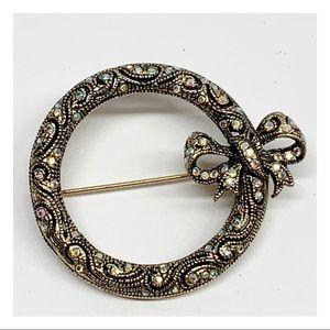 Gold tone antique look rhinestone wreath brooch